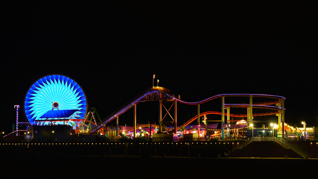a photo of the santa monica pier at night california