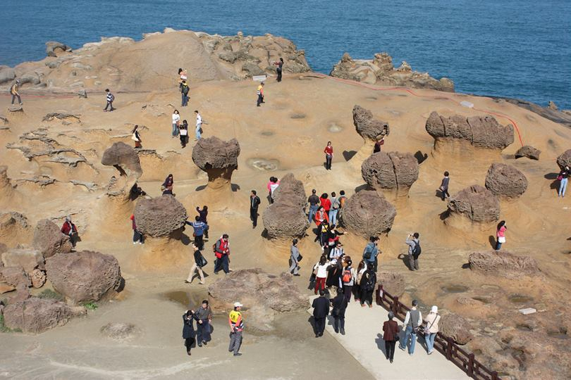 Yehliu Geo-Park in Wanli, Taiwan,  is truly unique because the rock layers near the seashore contain substantial quantities of limestone, which are subject to sea erosion, weathering and earth movements, thus making the 1,700 meter-long peninsula almost lunar-like in many ways.