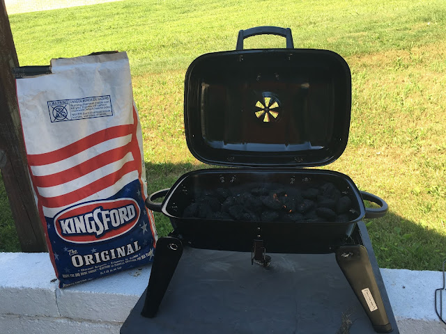 The grill and a bag of Kingsford Charcoal.