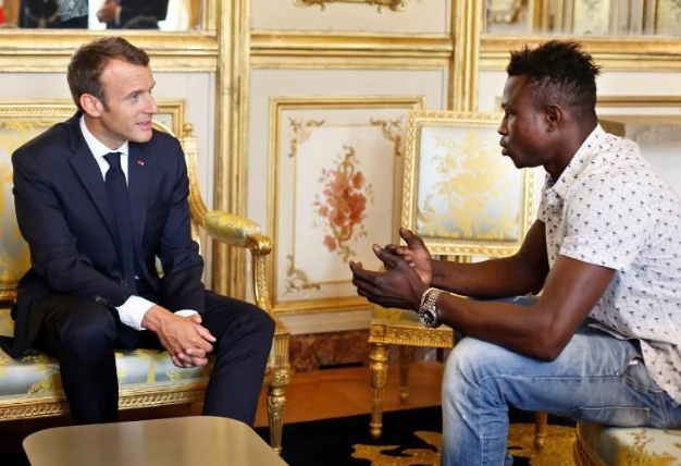 "Hero ""Spiderman"" who scaled building to save child meets French President, gets honorary citizenship and a job with the Paris fire service"