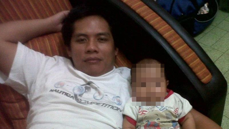 Pahinggar Indrawan bersama anaknya pada 2013