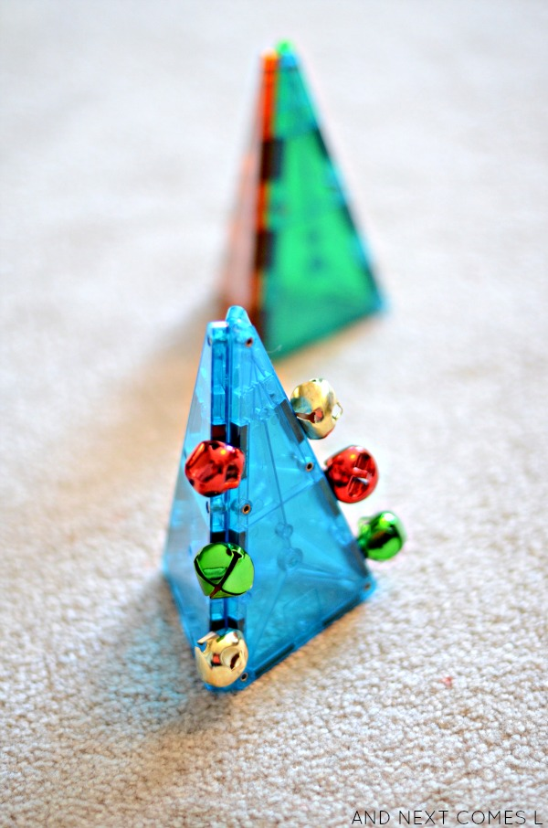 Christmas trees made using Magna-Tiles and jingle bells from And Next Comes L