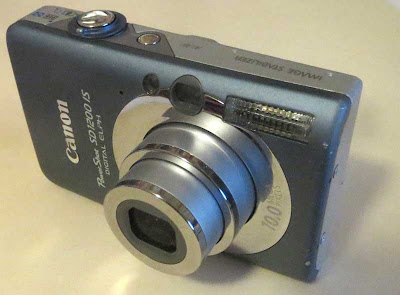 Silver-bodied digital point-and-shoot camera