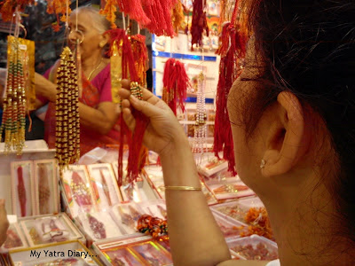 A woman choosing rakhi during the festival of Raksha Bandhan