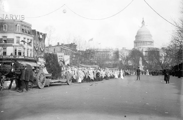Part of the 1913 Suffrage Parade. The signs read