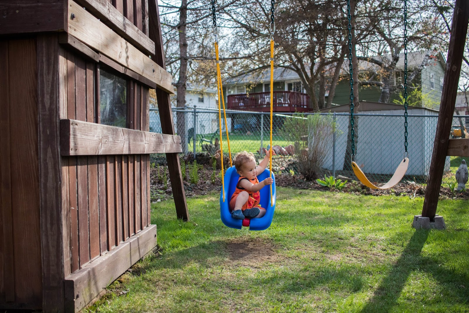 A low accessible swing for toddlers in our Montessori outdoor space.