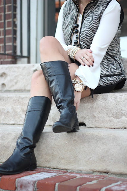 black riding boots, leather mini skirt, leather skirt, j. crew vest, bauble necklace