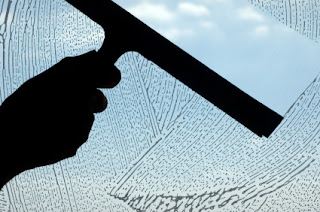 illustration of a hand cleaning a window making it more transparent