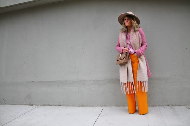 pink coat, what to wear with pink, what colour goes with mustard yellow, spring colours, wide leg trousers, spring outfit, pink and yellow color combo, color pairing with pink, toronto streetstyle, toronto style, toronto fashion blogger, designer bag, valentino rockstud bag.