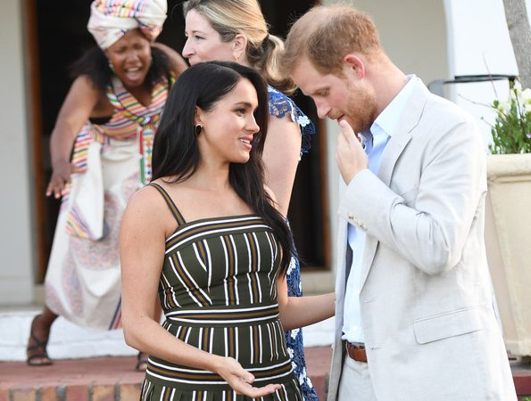 Meghan Markle, The Duchess of Sussex, wore Martin Grant pleated stripe long dress