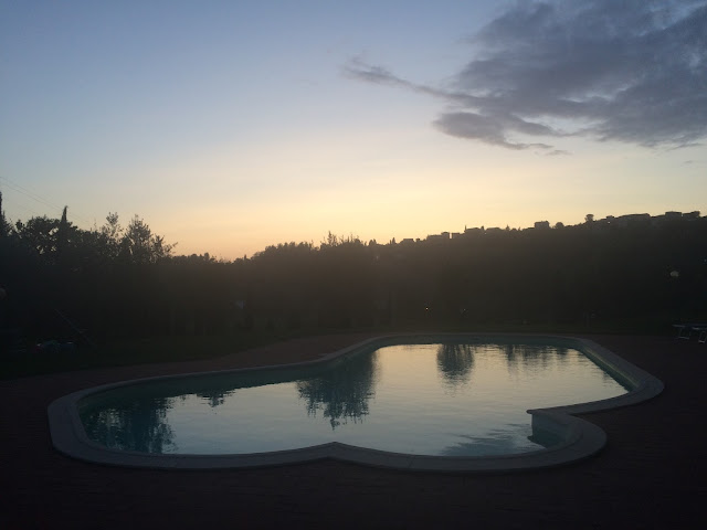 Sunset over Swimming Pool in San Miniato, Tuscany Countryside, Italy
