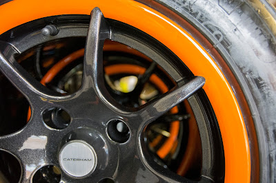 Freshly painted wheel rims on new wall mounted Caterham wheel rack