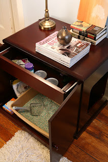 A litterbox in a cabinet or end table
