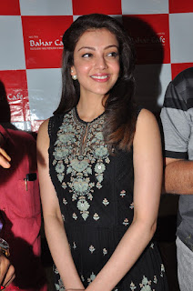 Kajal Aggarwal in lovely Black Sleeveless Anarlaki Dress in Hyderabad at Launch of Bahar Cafe at Madinaguda 026.JPG