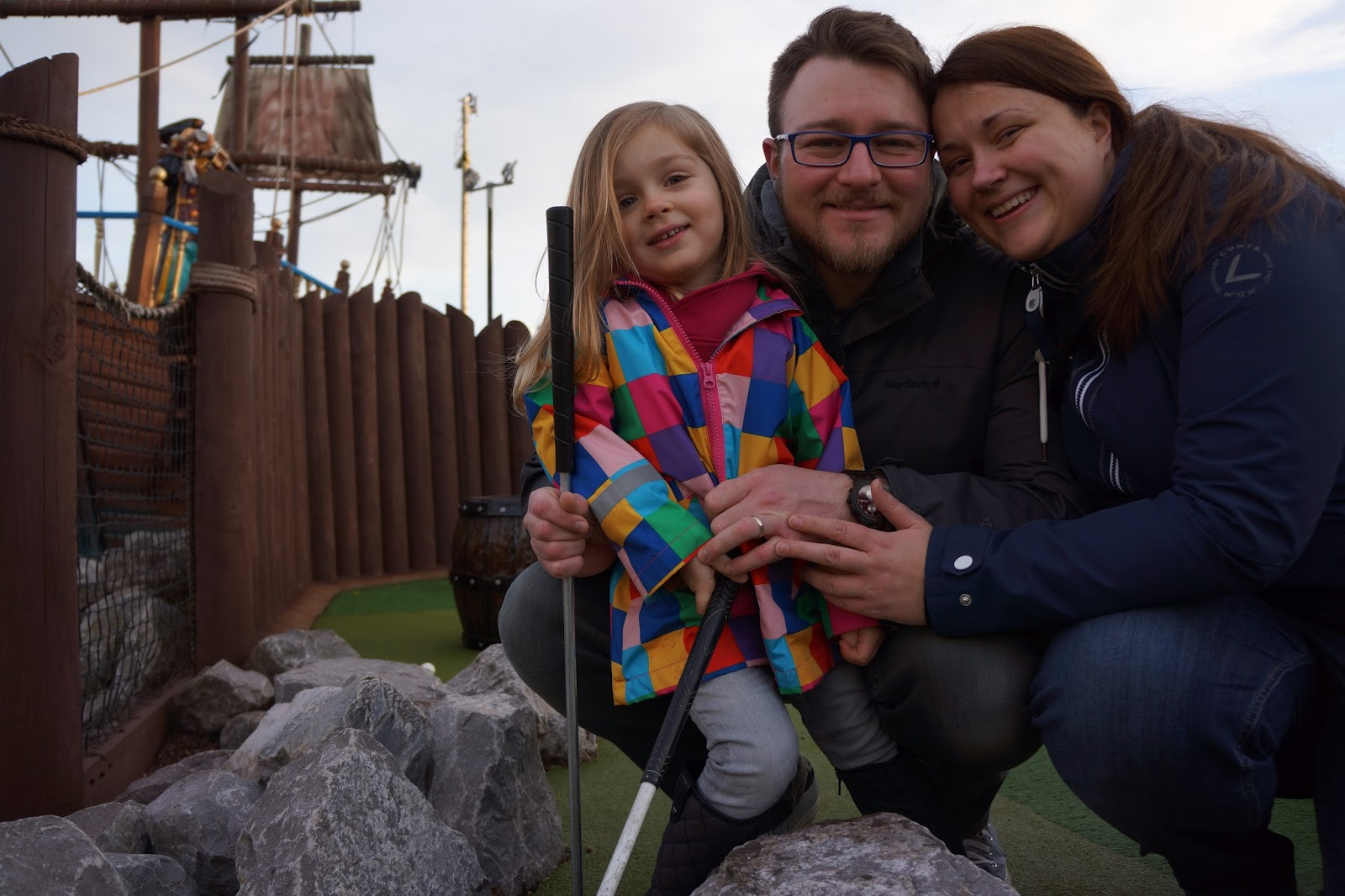 family picture playing mini golf