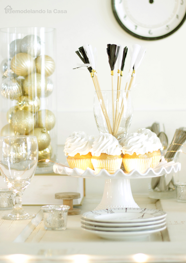 Cupcakes on stand, clock plates, Christmas ball ornaments, fancy glassware and paper straws