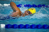 Image of swimmer in a pool lane doing front crawl drills, breathing from the side of his mouth