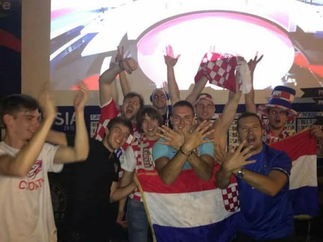 Croatian fans celebrate the victory with the Albanian symbol of double headed eagle