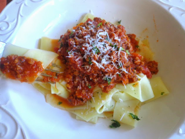 Top each serving of fettucine with the meat sauce