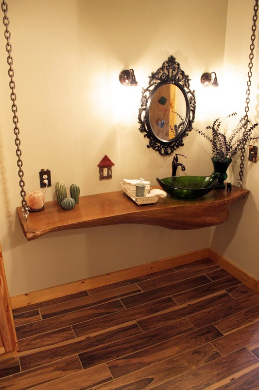 Log Home Tour Series: The Pioneer Girl's Cabin. This couple handbuilt their amazing cozy log cabin!  They used a slab of one the trees cut from their property as the countertop in their bathroom!
