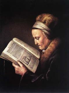 Painting of a woman reading a Bible