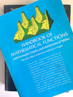 Handbook of Mathematical Functions, by Abramowtiz and Stegun, superimposed on Intermediate Physics for Medicine and Biology.