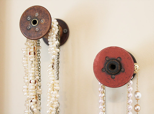 This DIYer used these old thread spools as necklace hangers