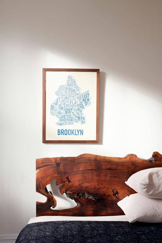 Wood slab headboard | Image by Chris Sanders via Design Sponge.