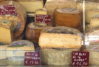 Regional cheeses in weekly market. Cherasco, Piedmont, Italy