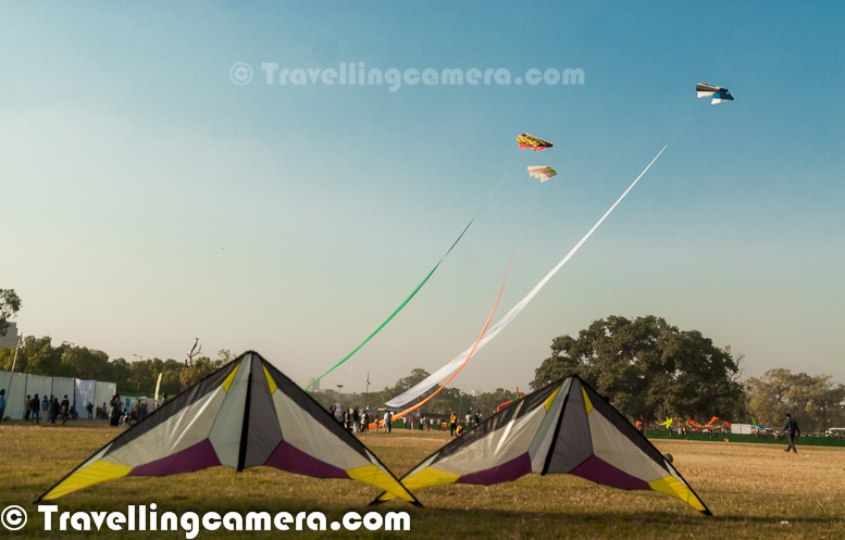 Every year Delhi Tourism Department organizes this wonderful festival for Kite Flying lovers and especially for kids of the country. Delhi has a long history of flying kites and all of us have some fond memories related to flying kites in our childhood. As time passes and one becomes busy with the mundane activities of everyday life, these memories are pushed behind to the back of our minds. The Kite Festival organized by Delhi Tourism brings back some of those memories. Let's check out this PHOTO JOURNEY to know more about Delhi Kite Festival.Here is how Delhi Chief Minister of Delhi expresses her viewpoint about Delhi International Kite Flying Festival -'Kite Flying has been an integral part of the culture of India and the rave response to the first Kite Flying Festival held in Delhi organized by Delhi Tourism is a proof that even in this age of Internet Technology and Social Media, kites have the ability of drag us out of our homes and go back to our childhoods for a bit. Owing to the obvious enthusiasm Delhi harbors for kites, we'll make this an annual event and celebrate the revival of this erstwhile fading tradition year after year. I congratulate Delhi Tourism for organizing the Kite Flying Festival in Delhi and for bringing out this vibrant souvenir, which is the perfect way to commemorate the event. And I would also like to thank the people of Delhi for making it a huge success.A photograph of 3D Kite flying in the sky around India Gate in DelhiFor the first time in November 2011, the skies over India Gate in Delhi were painted in rainbow colours and decorated with myriad shapes. Kites in all shapes and sizes took over the sky and brought the city to life. The first ever Kite-Flying Festival in Delhi had opened to an overwhelming response by participants and spectators.A passionate Kite flyer from Great Britain who seemed one of the most energetic Kite-flyer on the ground. Most of the kite flyers had some assisting people with them, but he was handling multiple kites on his own. People of all ages, families, couples, and children gathered around in the lush grounds near India Gate and witnessed the unfolding of this event with awe.  It was as if Delhi had been waiting for such an event for ages.  None of the events lacked participation. From kite flying to kite fighting to other cultural events, all were teeming with participants and spectators.  The atmosphere was charged up and spirits as high as a kite can go, encouraging us to consider the possibility of holding this festival every yearThere were various types of kites flying in the sky. Here is one of the colorful kite with unique shape and the man handling this kite is a member of Chennai Kite Club.Ever since the beginning of human existence, the obsession with the sky has led to inventions after inventions to help us in our bid to conquer the sky. And it was because of this fascination that our ancestors flew the first kites.   Each movement of a kite while it's on a flight inspires poetry. Our hearts dive when it plunges and when it soars through the sky and achieves heights we can never hope to achieve owing to our human limitations, our spirit flies with it. A kite embodies human desires and it is no wonder then that it symbolizes freedom, joy, prosperity, fortune, and all things good to us.Kite flying has been an age-old tradition in India but now with the intrusion of technology and social media, sports like kite-flying has started retreating into the shadows. Kite Festivals, held from time to time, in different parts of the country are amongst some of the initiatives to celebrate and revive this fading sport. Kites have been a part of our tradition since ancient times and even today they are flown to celebrate various festivals and sentiments. Culturally, for Indians, Kites represent everything that is good – happiness, prosperity, freedom, and peace.Makar Sankranti, the festival that celebrates the movement of the sun into the Northern Hemisphere, is all about flying kites. On this day, especially in Gujarat and Rajasthan, families flock on terraces and indulge in kite flying and fighting from sunrise to sunset and even beyond that. Basant Panchami is another festival on which kite-flying is common.  In Delhi, kites are flown on the Independence Day to celebrate freedom. Tricolors are the most popular kites to be flown on this day. According to Bhai Mian, the man who can rightfully be termed as one of the Godfathers' of the art of Kite making and flying in Delhi, kites are still flown daily in Old Delhi. He also rubbishes all claims that the tradition is fading. According to him, children are as enthusiastic about kites as they used to be during his youth.Kite Flying is a popular sport in the whole of Asia. In Afghanistan , kite flying suffered till some years back when it was banned. However, now the sport is slowly reviving. In Pakistan, it often transforms into Kite Fighting and is especially popular during the spring. China, often thought to be the birthplace of kite flying, also houses Weifang, the kite flying capital of the world. China also boasts of the largest kite museum in the world.  The photograph above shows one of the kite flying expert from Indonesia.In Europe, Kite Flying is a part of the culture in Greek and Cyprus. Kites of the British Overseas Territory of Bermuda hold world records for altitude and duration. In some countries of South America, the traditions are surprisingly close to those in India. Kites are flown on Independence Day in Chile.  In Guyana, they're flown around EasterAll over the world, kite festivals welcome international participation. Several of these festivals have been around for some years while new ones are cropping up every year. It seems the entire world is awakening to the charm of kites now.Common belief is that kites were introduced in India by a couple of Chinese Travellers. However, that is where the similarity between Indian and Chinese kites ends. Modern Indian fighter kites are completely different from elaborate Chinese versions. And lately, Chinese kites and strings have started making their appearance in Indian Markets though Bhai Mian maintains that Indian kites are better than their Chinese counterparts in maneuverability and agilitMany believe that kite flying dates back to the time of Mahabharat when they were used to pass messages from one kingdom to another.  However, the earliest evidence of Kite Flying in India is in form of miniature paintings from the Mughal Period dating back to the 1500s. There are many references of lovers delivering romantic messages to each other using kites.   Gradually kite-flying and kite-fighting evolved into full-fledged sports and kites started being flown to celebrate various occasions such as the onset of spring, the Independence Day, and Uttarayan.  And now, history is again being rewritten by dedicated festivals being organized to celebrate kites and all that they stand for. Kite festivals are celebrated all across India with great enthusiasm. The festival in Rajasthan is called the Desert Kite Festival. And along with the main festival in Jodhpur, several parallel celebrations are organized in other cities of the state. Kites also unleashed their magic towards the south. This year, in Hyderabad, the Great Hyderabad Adventure Club organized a Kite Flying festival on the 15th of January. And in Kerala, the second Kerala Kite Festival was organized on January 22nd and 23rd. All of these festivals were received with palpable excitement by the flyers. However, the biggest Kite Festival in India is perhaps the one that is organized on Makar Sankranti in Ahmedabad, Gujarat. This festival has been held every year with increasing fanfare since 1989. The numbers, sizes, shapes, and varieties of kites flown during this festival are outrageous and kite flyers from across the globe attend this festival and showcase their kites and their kite flying skills for the benefit of the others. With so many kites in the sky, it is a wonder how these kites, especially the huge, intricate ones manage to survive. Some facts about Kite Flying :)1.    The Chinese believe that when we look up at a kite in the sky, our mouth opens a bit. This helps in getting rid of the excess heat in the body and, thus, maintaining a healthy Yin-Yang Balance.2.    Japan banned kite-flying in 1760 because it was distracting too many people from their work.3.    East Germany banned large kites because it was thought that they could potentially be used to lift someone across the Berlin Wall4.    In 1855, the Russians towed torpedoes with great accuracy using kites.5.    Kite-flying is growing faster than most other sports in the world6.    Kites have been used for various purposes throughout the world. The uses include fishing, war propaganda, lifting material to workmen working on structures of great heights, lifting observers in wars, and so on.Overall it was great experience to see lot of colorful kites in the sky and looking for next year's Kite Festival in Delhi !!!