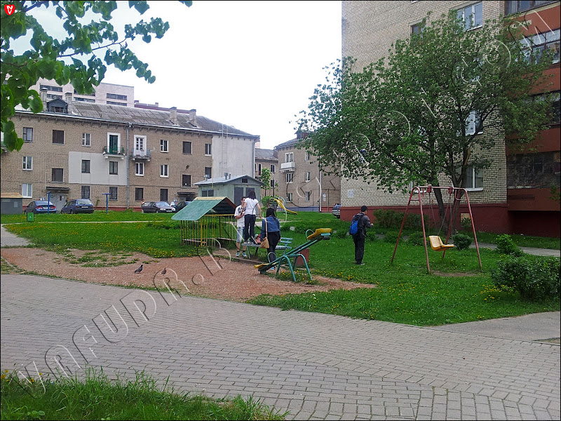 Minsk. Belarus. Invasion of the Chinese. On a bench in the children's village do run neither hooligans nor drunkards
