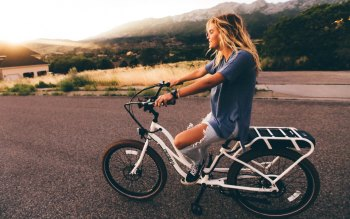Wallpaper: Girl on Bike at Dusk