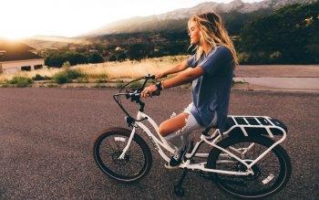 Wallpaper: Girl on Bike at Dusk