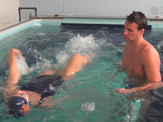 Ryan Lochte instructs USA Today reporter Nicole Auerbach in the Endless Pool