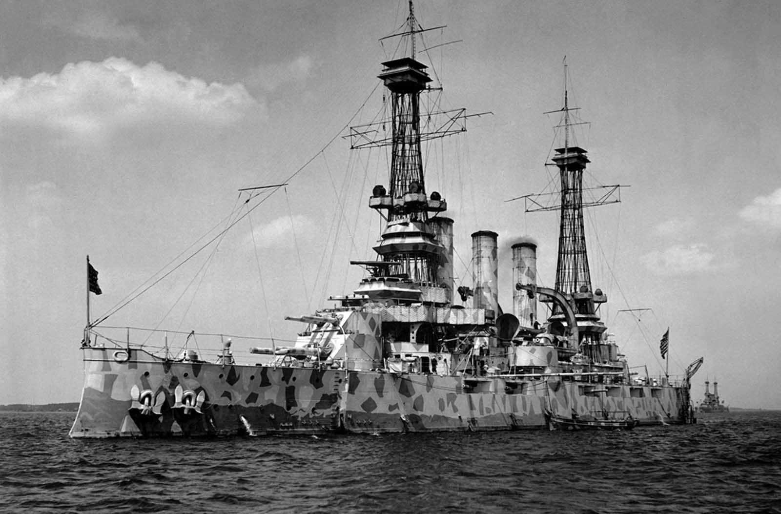 The USS New Jersey (BB-16), a Virginia-class battleship, in camouflage coat, ca 1918.