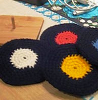http://www.ravelry.com/patterns/library/vinyl-record-coasters-crochet-version