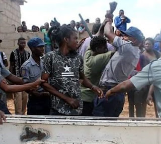 Photos: Man almost lynched by angry mob after he stabbed another man to death during fight over ownership of a prostitute