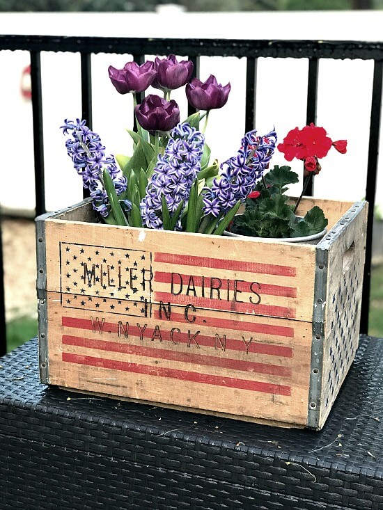 American flag crate filled with flowers