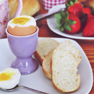 Breakfast with eggs and strawberries