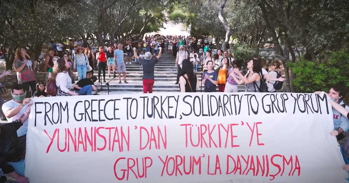 Artists In Athens Release Video Of Beautifully Orchestrated Performance In Solidarity With Turkish Grup Yorum Musicians Who Died On Hunger Strike Fighting For The Right To Freedom Of Expression Against Erdoğan's Inhumane Regime