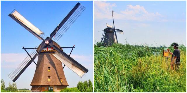 Molino y pintor pintando cuadro con molinos holandeses en Kinderdijk en los Paises Bajos
