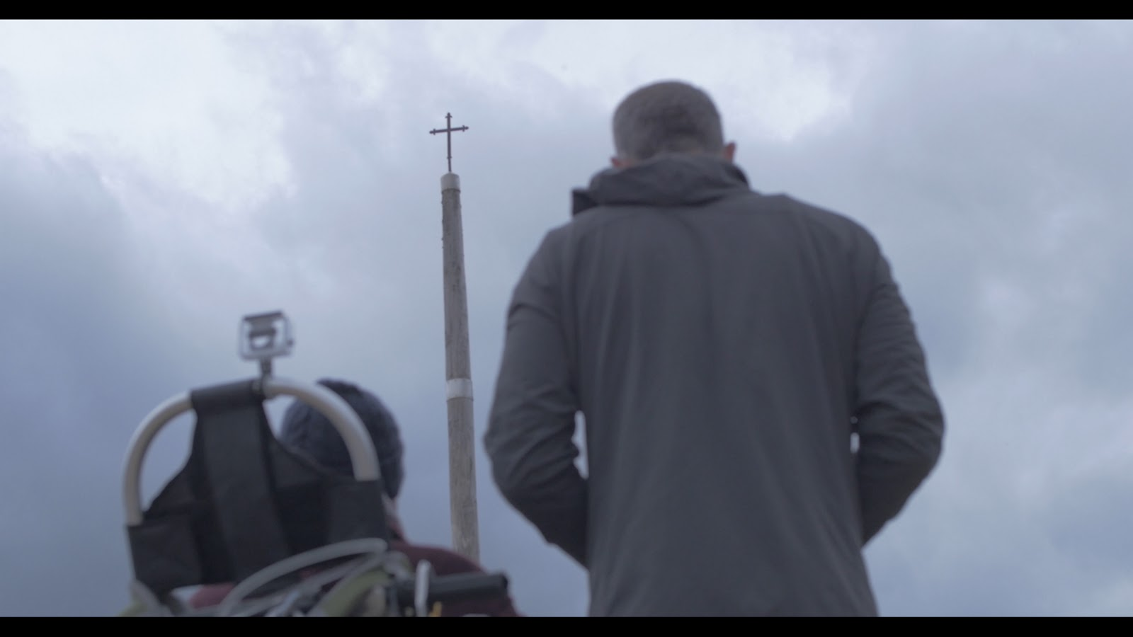 Not only did the Camino present its outward struggles, the guys looked inward as well. This scene shows Patrick and Justin standing before the Cruz de Ferro (Iron Cross) and was one of the most poignant and profound moments in the book. Photo: © IllPushYou.com. Unauthorized use is prohibited.