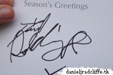 Daniel Radcliffe signs Christmas card for charity