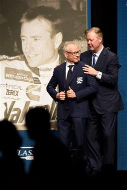 Mark Martin receives his Hall of Fame jacket from NASCAR Chief Executive Officer and Chairman Brian France.