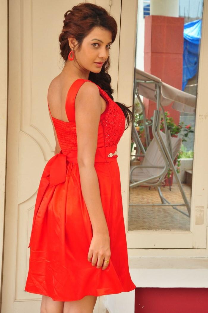 Actress Deeksha Panth Stills in Red Short Dress at Banthi Poola Janaki Press Meet  0024.jpg