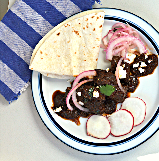 Carne Asada is perfect for tacos or just served with rice. It is cooked with a rich chili sauce and turns into a magical dish! #mexicanfood #carneasada #pork #tacos www.thisishowicook.com