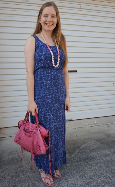 blue printed jersey empire maxi dress with sorbet balenciaga city bag and pink studded sandals easy summer airport style | away from blue