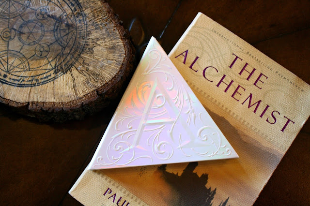 Kat Von D Holographic Alchemist Highlighter Palette blog image with book
