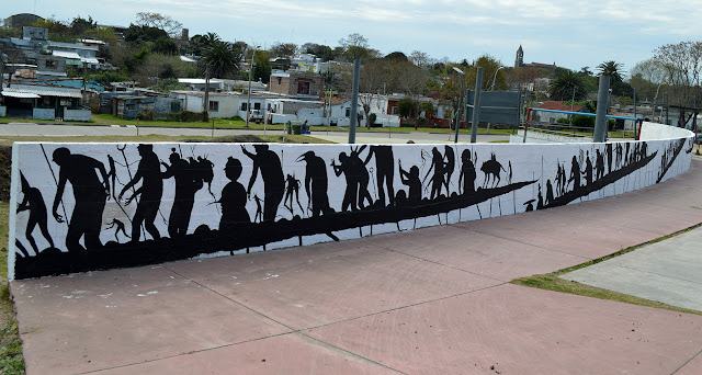 David De La Mano is currently in Uruguay where he just finished working on this long mural somewhere on the streets of Montevideo.