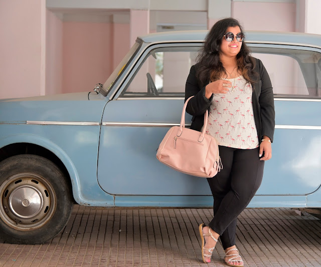 semi formal outfit black peach printed top pink bag blue fiat car